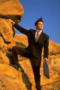 A person in a suit and tie Description generated with high confidence